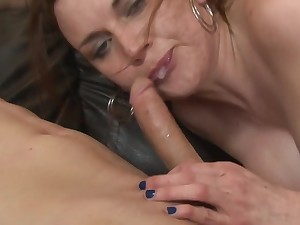 A brunette is handling a cock with her inviting hands really well