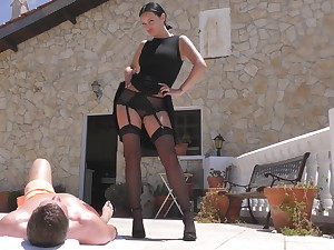 Automated skirt acts dominant with the dick while fucking in the sun