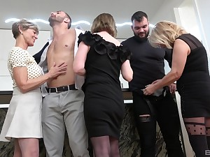 Insolent matures undress and share an obstacle lad's big dicks in a crazy home orgy