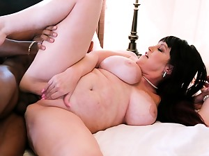 Bosomy frizzled brunette with big boobs fucks upstairs couch