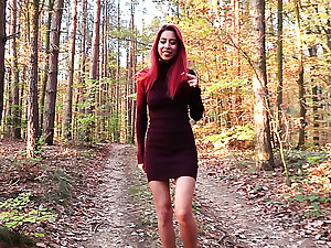 Sexy bright babe with bright red barb strips and flashes tits in the woods